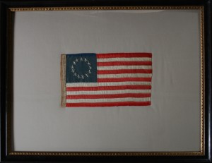 Pressure mount of a historic 13-star flag, using the owners frame.
