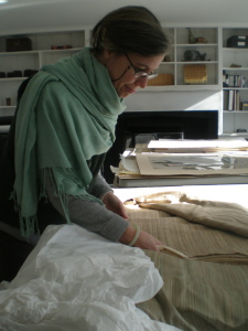 Historic textiles and fabric wall coverings are examined and treated by Gwen Spicer, textile conservator