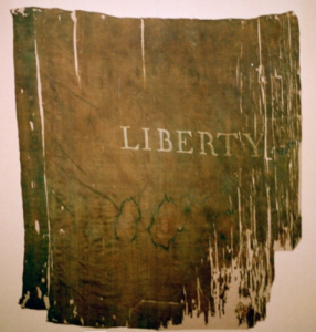 Historic Liberty Flag conserved and mounted by Spicer Art Conservation. Located in upstate New York, we specialize in the preservation of historically significant battle flags, banners, textiles, garments and objects