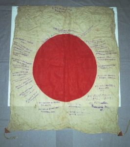 A signed silk Japanese Flag from WWII before it was conserved and mounted by textile conservator and flag restoration expert Gwen Spicer of Spicer Art Conservation located in Upstate New York and serving clients in the United States and abroad with historic flag conservation, restoration, repair and framing and mounting for display and exhibit
