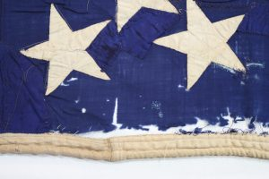 Close-up of canton of Civil war flag showing damage and previous repairs