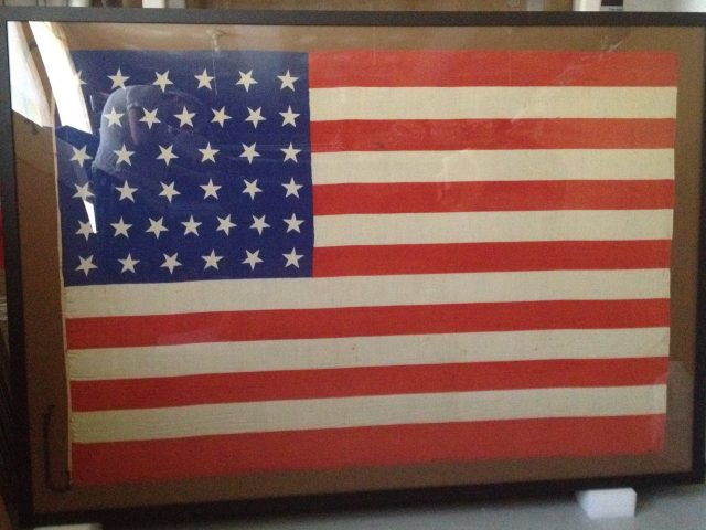 Historic and antique flag repair and restoration, conservation by professional textile conservator, conservation studio specializing in flags and banners and historic textiles
