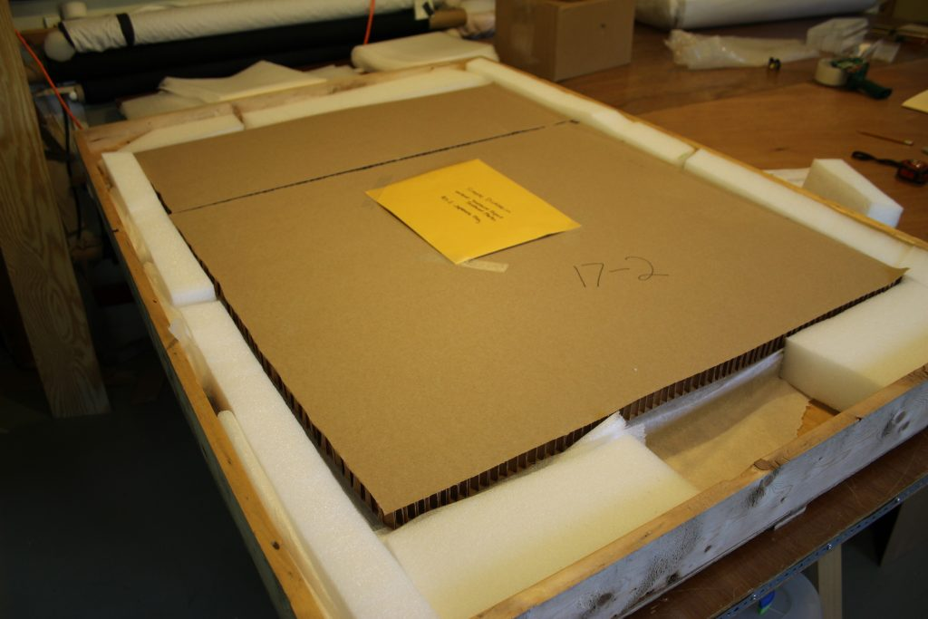 Shipping container, packaging art, conservation of textiles, custom shipping of artifacts after conservation, preservation, repair, mounting of artifacts.
