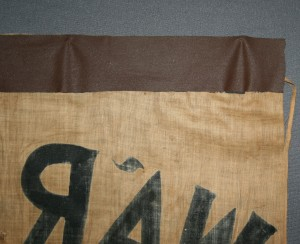 Reverse of banner before treatment with detail of tape.