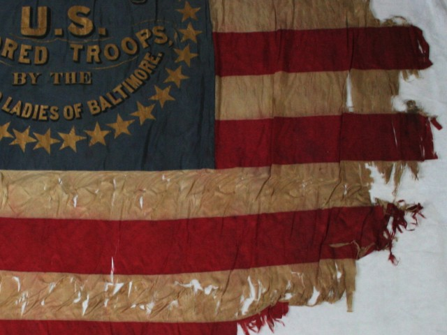 Flag conservation, repair, framing and restoration preservation of historic textiles, civil war, antique flag repair, silk flag, battle flag, flag expert Gwen Spicer