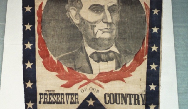 Before textile conservation of historically significant banner from the Lincoln presidency