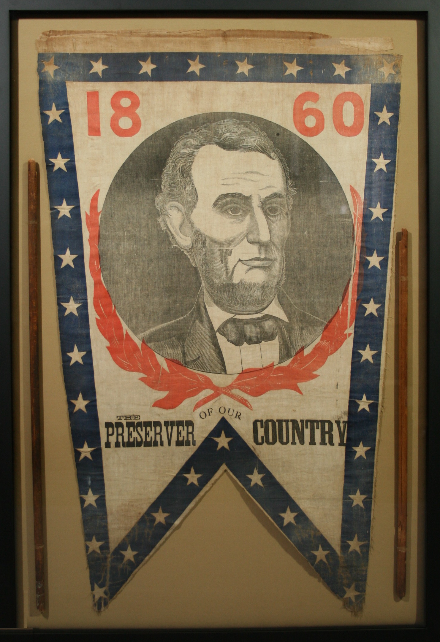 Historic banner textile from the Lincoln presidential campaign conserved and mounted in an archival frame.