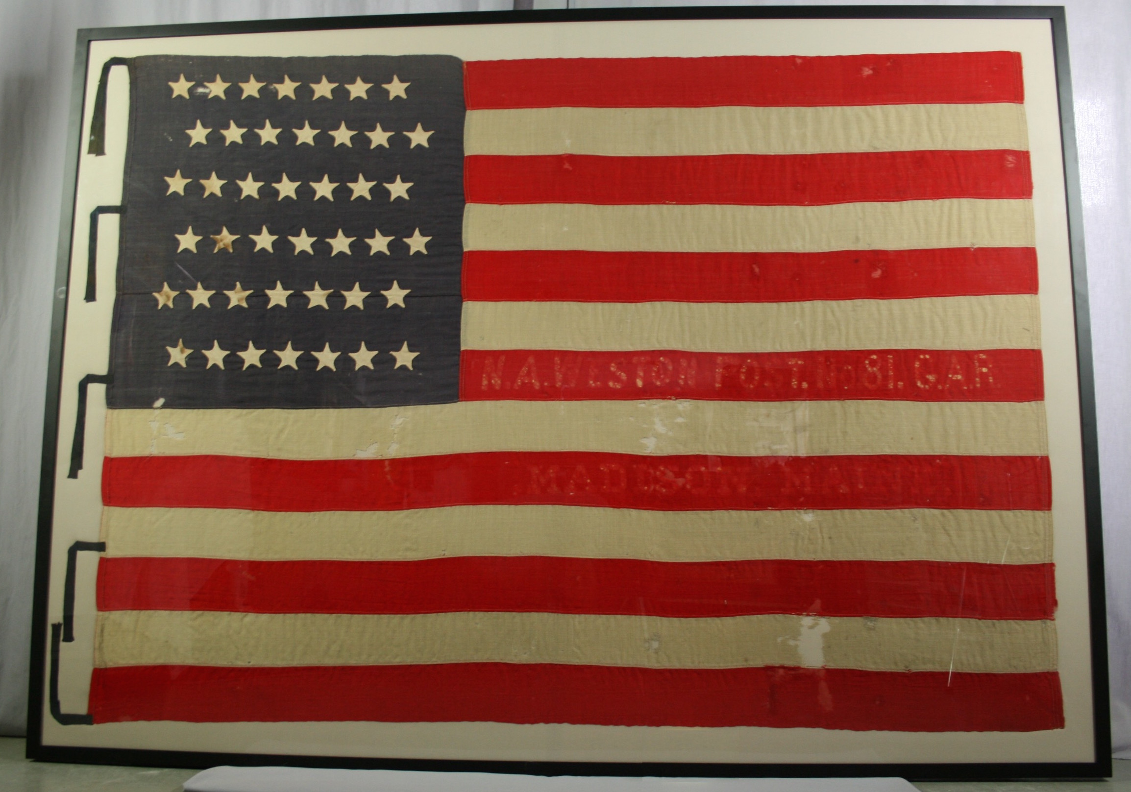Pressure mount of historically significant American flag by Spicer Art Conservation, experts in the care and preservation of flags, banners, and textiles.