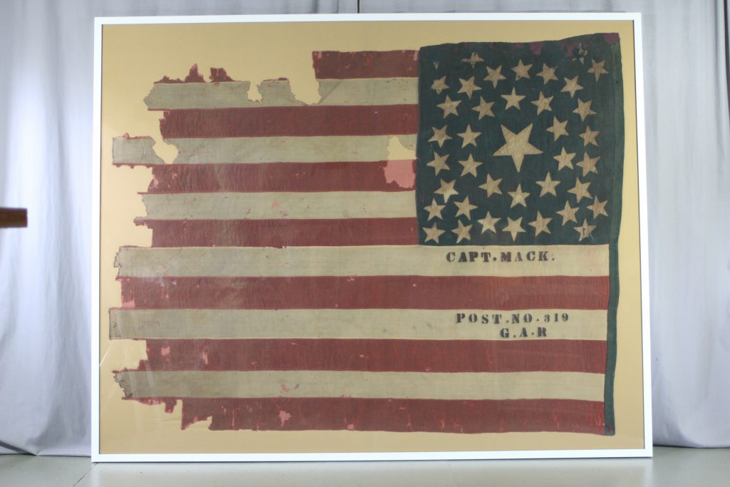 Pressure mount of historic battle flag, Civil War flag, 38 star flag, preservation of flag, repair of antique textiles, conservator and textile expert Gwen Spicer