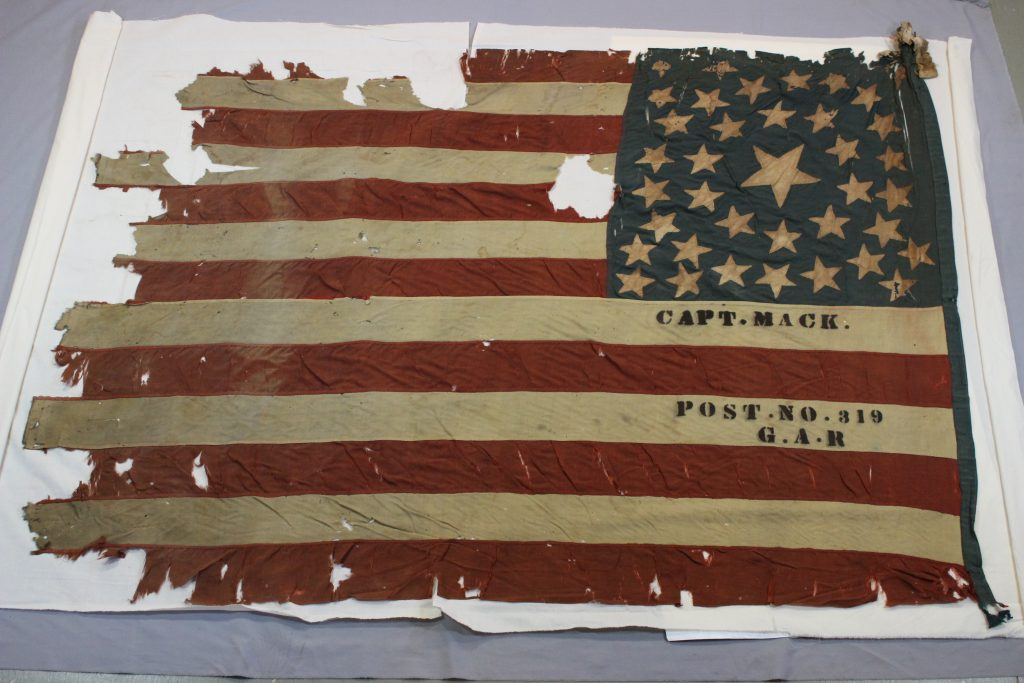 Civil war flag before conservation by textile conservator and flag expert Gwen Spicer