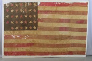 29th Missouri flag before treatment, conservation, preservation and archival mounting, pressure mount of historic battle flag from the Civil War